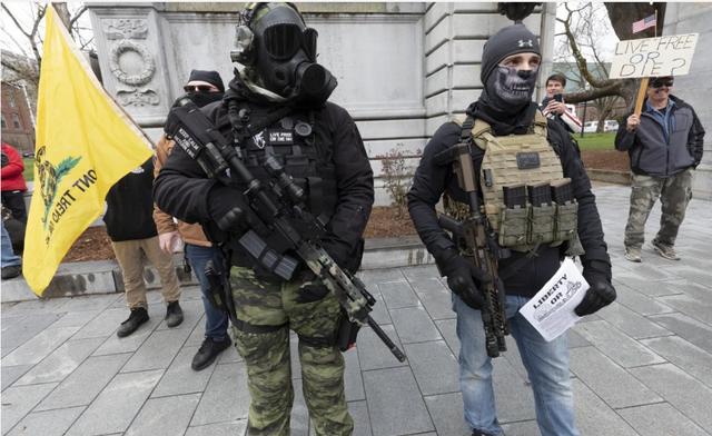 美国确诊新冠病毒死亡病例超4万 多地出现持枪抗议游行