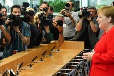 默克尔也忍不下去了,她明确表示将站在被特朗普攻击的女性一边